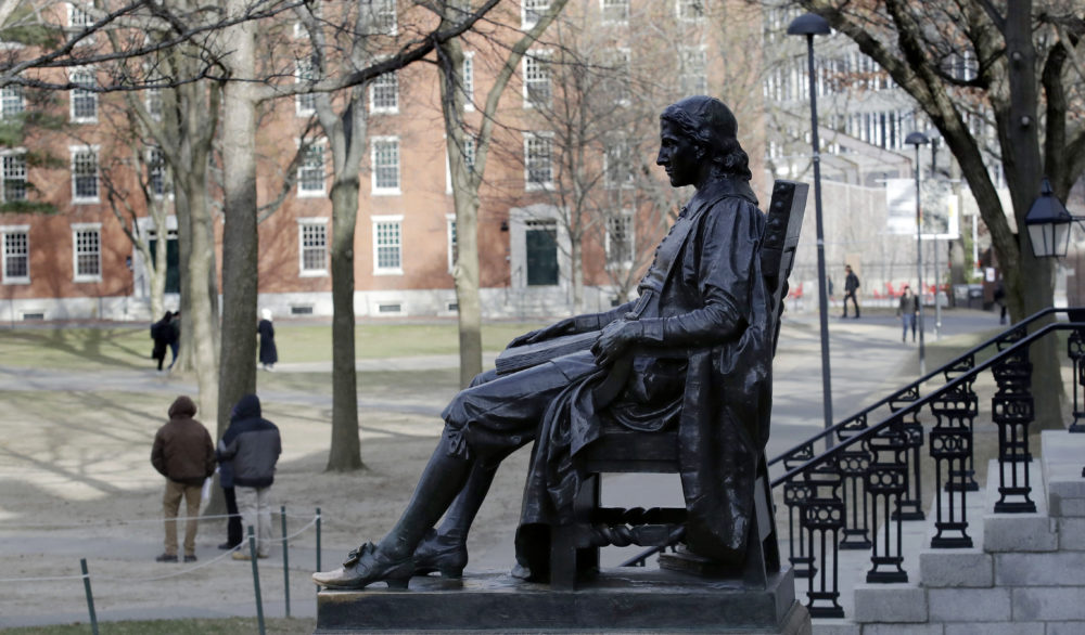 In this 2018 photo, the John Harvard statue looks over Harvard Yard at Harvard University. (Charles Krupa/AP)