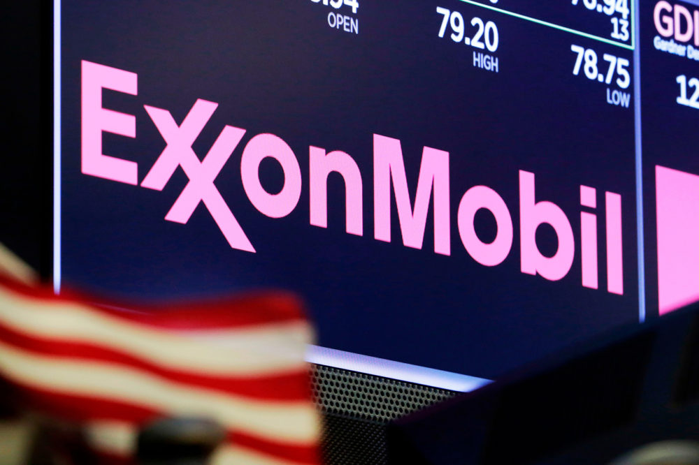 In this April 23, 2018, file photo, the logo for ExxonMobil appears above a trading post on the floor of the New York Stock Exchange. (Richard Drew, File/AP)