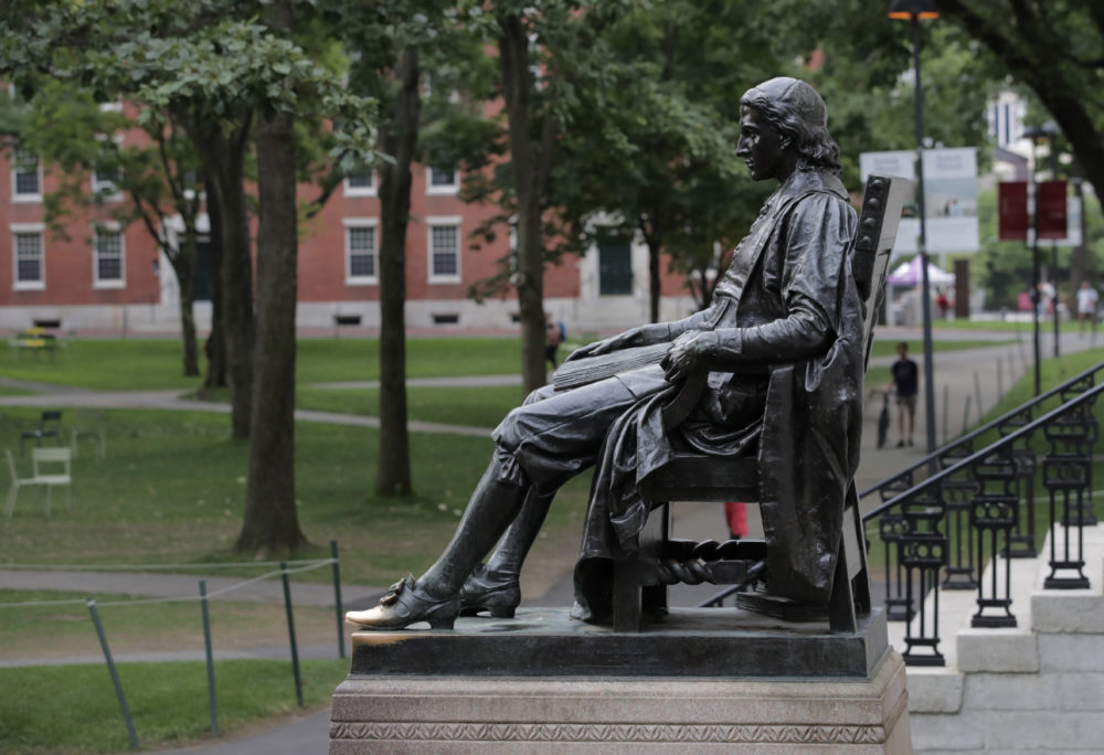 The statue of John Harvard in Harvard Yard at Harvard University (Charles Krupa/AP).