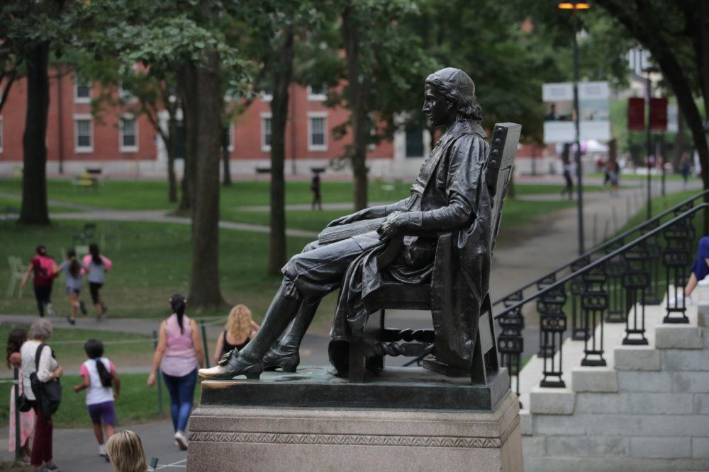 The statue of John Harvard in Harvard Yard at Harvard University in Cambridge, Mass., Tuesday, Aug. 13, 2019. (Charles Krupa/AP)