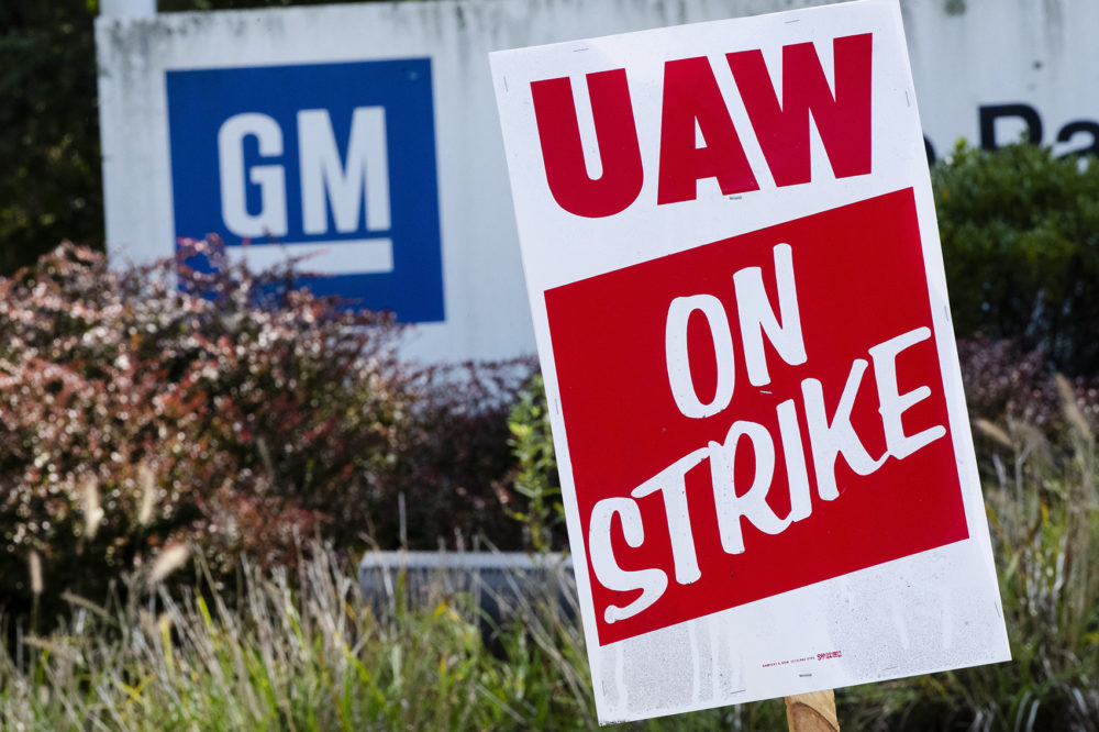 In this Sept. 23, 2019, file photo a sign is posted during a demonstration outside a General Motors facility in Langhorne, Pa. (Matt Rourke, File/AP)