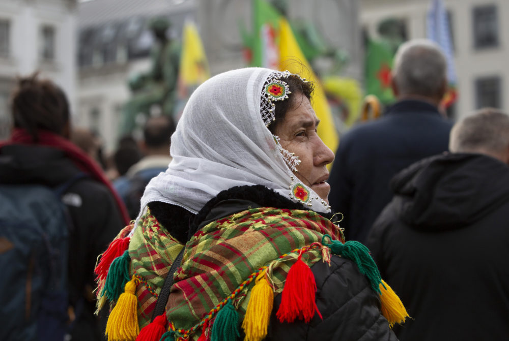 A Kurdish woman participates in a demonstration outside European Parliament in Brussels, Wednesday, Oct. 9, 2019. Turkey launched a military operation Wednesday against Kurdish fighters in northeastern Syria after U.S. forces pulled back from the area, with a series of airstrikes hitting a town on Syria's northern border. (Virginia Mayo/AP)