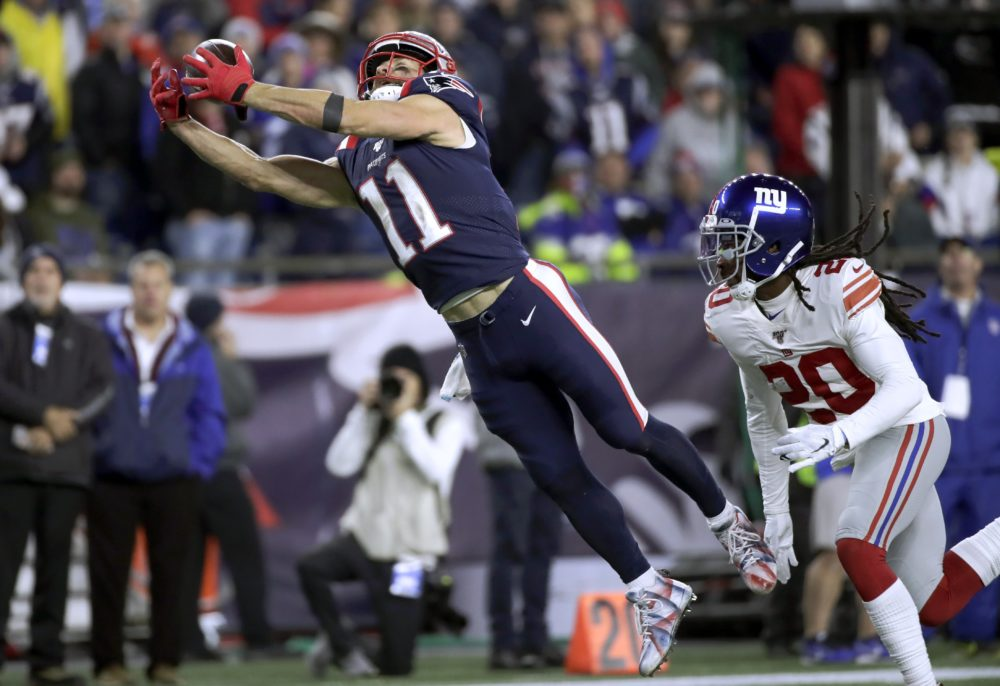 New England Patriots wide receiver Julian Edelman stretches out to catch a pass in front of New York Giants cornerback Janoris Jenkins, right, in the second half ofthe game Thursday (Elise Amendola/AP)