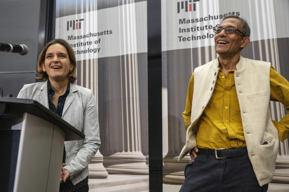 Esther Duflo, left, and Abhijit Banerjee speak during a news conference at MIT on Monday. Banerjee and Duflo, along with Harvard's Michael Kremer, were awarded the 2019 Nobel Prize in economics for pioneering new ways to alleviate global poverty. (Michael Dwyer/AP)
