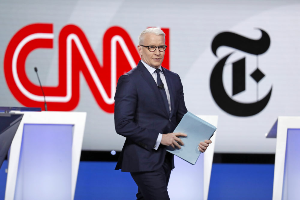 Anderson Cooper, CNN anchor, walks onstage for a Democratic presidential primary debate hosted by CNN/New York Times at Otterbein University, Tuesday, Oct. 15, 2019, in Westerville, Ohio. (John Minchillo/AP)