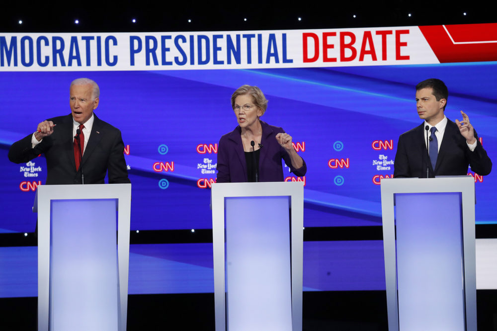 Democratic presidential candidate former Vice President Joe Biden, left, Sen. Elizabeth Warren, D-Mass., center and South Bend Mayor Pete Buttigieg speak during a Democratic presidential primary debate hosted by CNN/New York Times at Otterbein University, Tuesday, Oct. 15, 2019, in Westerville, Ohio. (John Minchillo/AP)