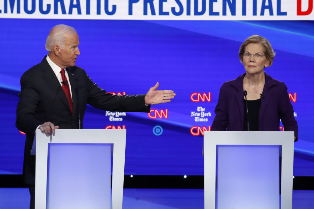 Democratic presidential candidate former Vice President Joe Biden gestures toward Sen. Elizabeth Warren, D-Mass., during a Democratic presidential primary debate at Otterbein University Tuesday in Westerville, Ohio. (John Minchillo/AP)