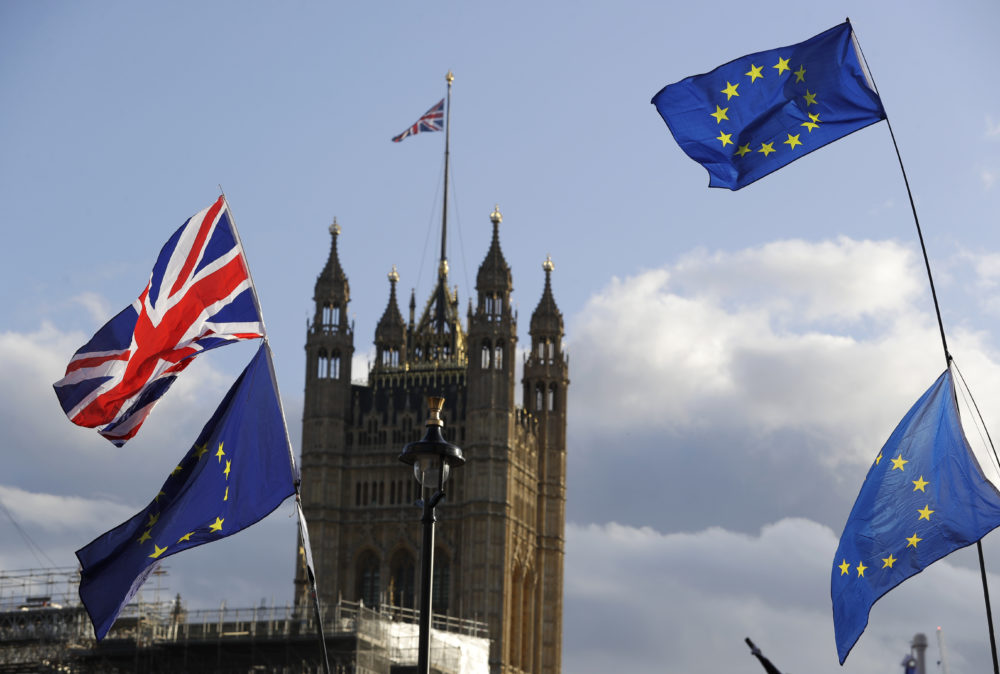 Union Jacks and EU flags fly over Britain's Parliament in Londonn. (Kirsty Wigglesworth/AP)