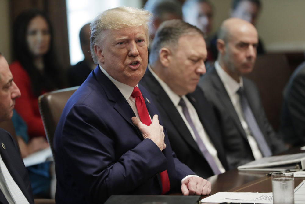 President Trump speaks during a Cabinet meeting in the White House, Monday, Oct. 21, 2019. Secretary of State Mike Pompeo is right of the President. (Pablo Martinez Monsivais/AP)