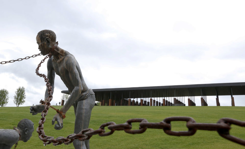 In this Sunday, April 22, 2018, file photo, a statue of a chained man is on display at the National Memorial for Peace and Justice, a new memorial to honor thousands of people killed in racist lynchings, in Montgomery, Ala. Facing an impeachment inquiry that he and supporters claim is illegal, President Donald Trump tweeted Tuesday, Oct. 22, 2019, that the process is a lynching. (Brynn Anderson/AP)