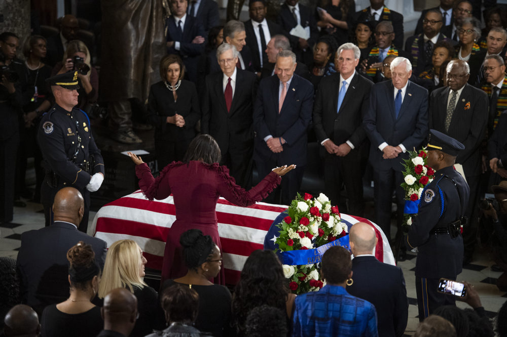 Maya Rockeymoore Cummings, widow of the late Rep. Elijah Cummings, D-Md., pauses at his casket in Statuary Hall as Congressional leaders look on, during his memorial service on Thursday, Oct. 24, 2019. (Tom Williams/Pool via AP)
