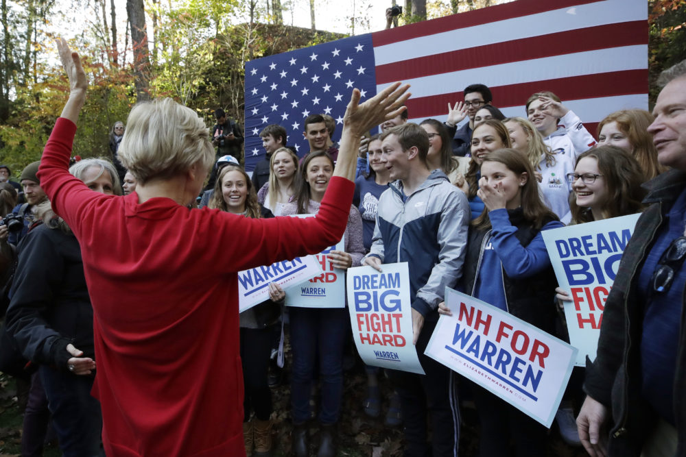 Democratic presidential candidate Sen. Elizabeth Warren, D-Mass., greets area high school students at a campaign event on the campus of Dartmouth College, Thursday, Oct. 24, 2019, in Hanover, N.H. (AP Photo/Elise Amendola)