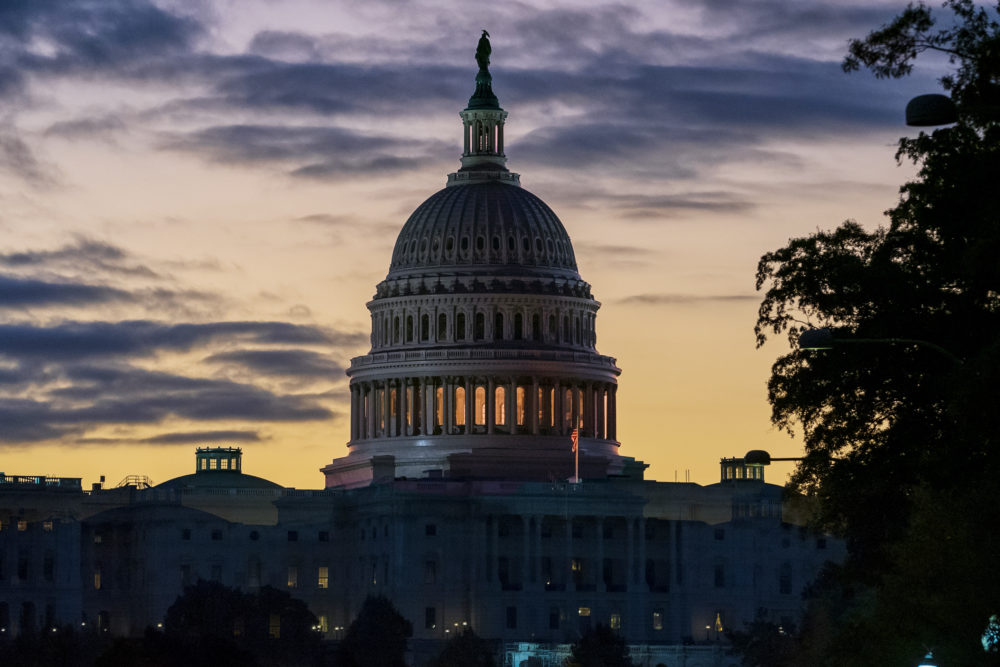 The Capitol is seen at dawn on the morning after Speaker Nancy Pelosi announced the U.S. House will vote on a resolution to affirm the impeachment investigation, (J. Scott Applewhite/AP)