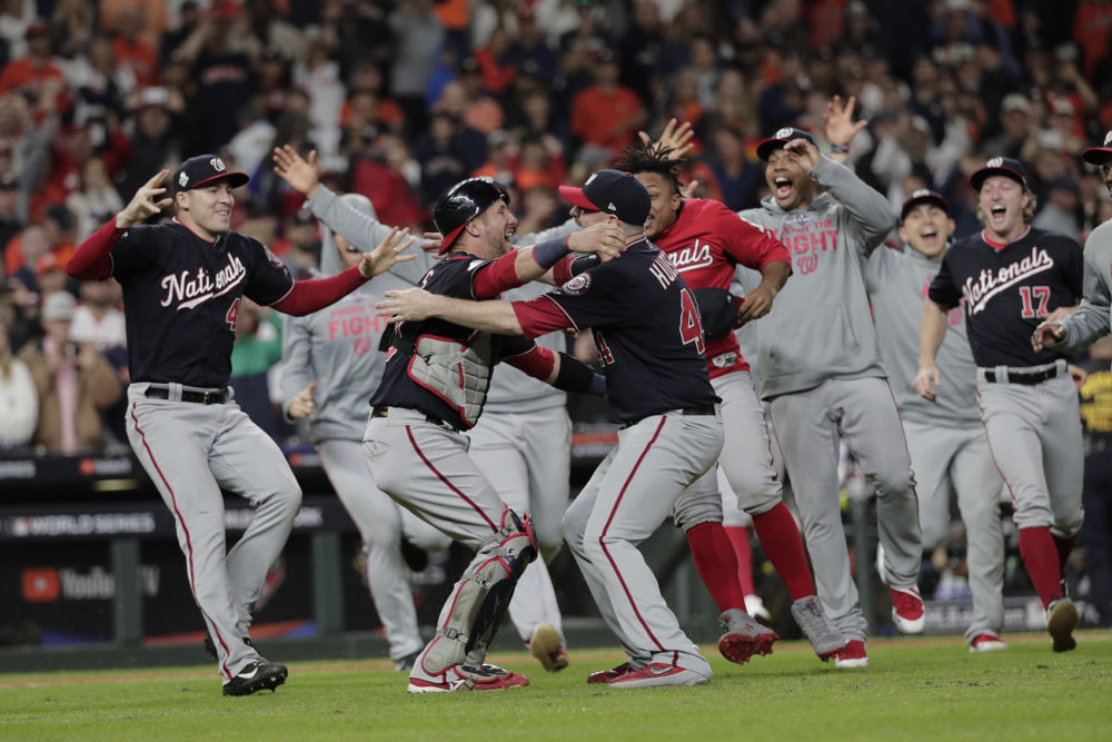The Washington Nationals celebrate after Game 7 of the World Series against the Houston Astros Wednesday, Oct. 30, 2019, in Houston. The Nationals won 6-2 to win the series. (David J. Phillip/AP)