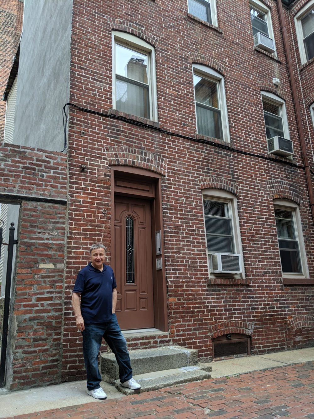 Anthony Martignetti stands on Powers Court in the North End in 2019. (Jamie Bologna/WBUR)
