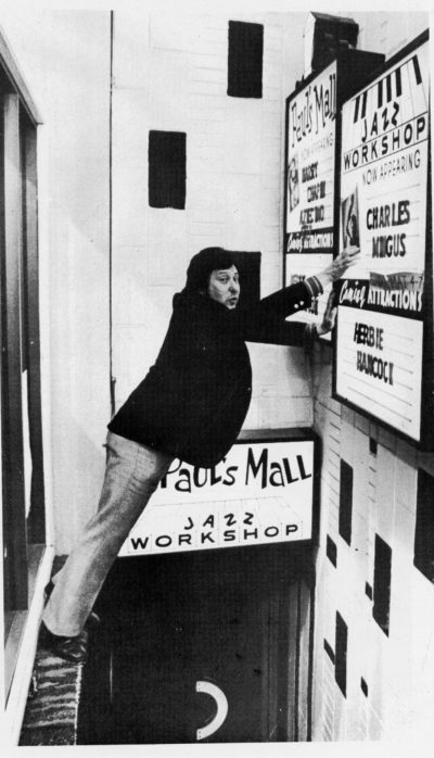 Fred Taylor updating a marquee at Paul's Mall. (Courtesy)