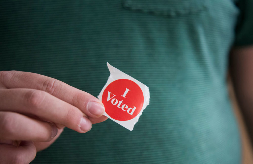 "A voter in Minnesota holds their ""I Voted"" sticker. (Stephen Maturen/Getty Images)"
