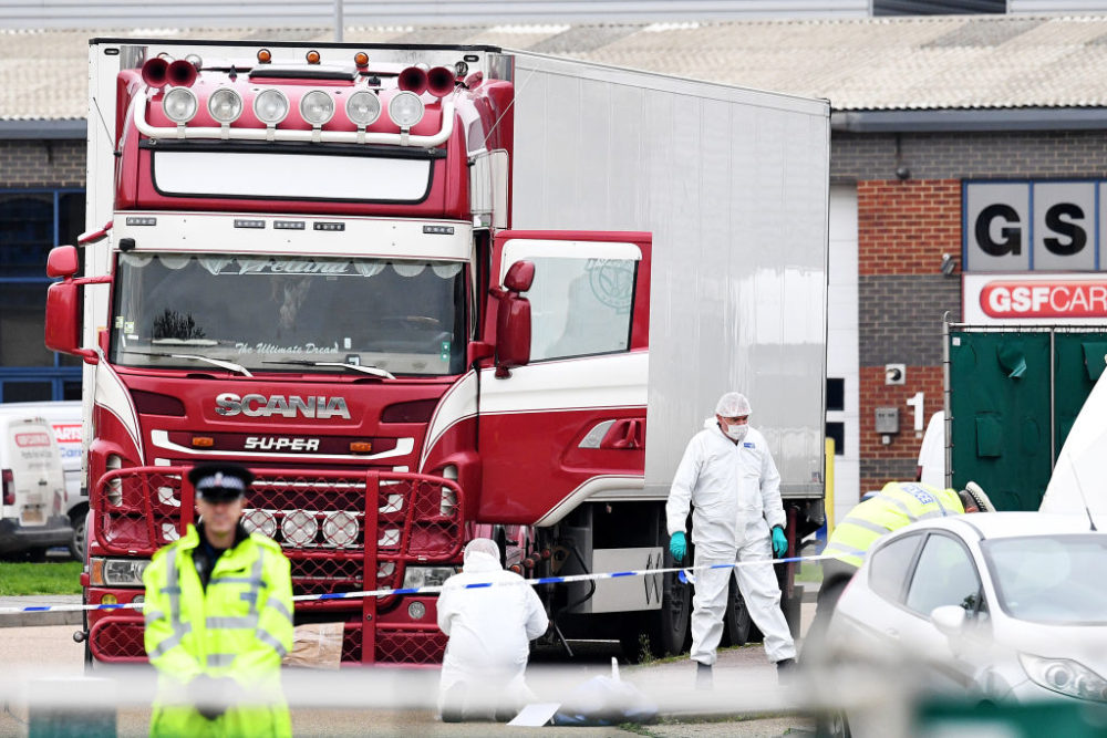 Police and forensic officers investigate a lorry in which 39 bodies were discovered in the trailer, as they prepare move the vehicle from the site on October 23, 2019, in Thurrock, England. (Leon Neal/Getty Images)