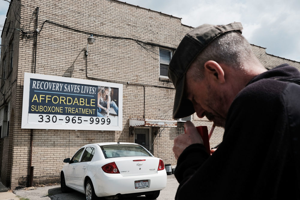 A man walks by a billboard for a drug recovery center in Youngstown on July 14, 2017 in Youngstown, Ohio. (Spencer Platt/Getty Images)