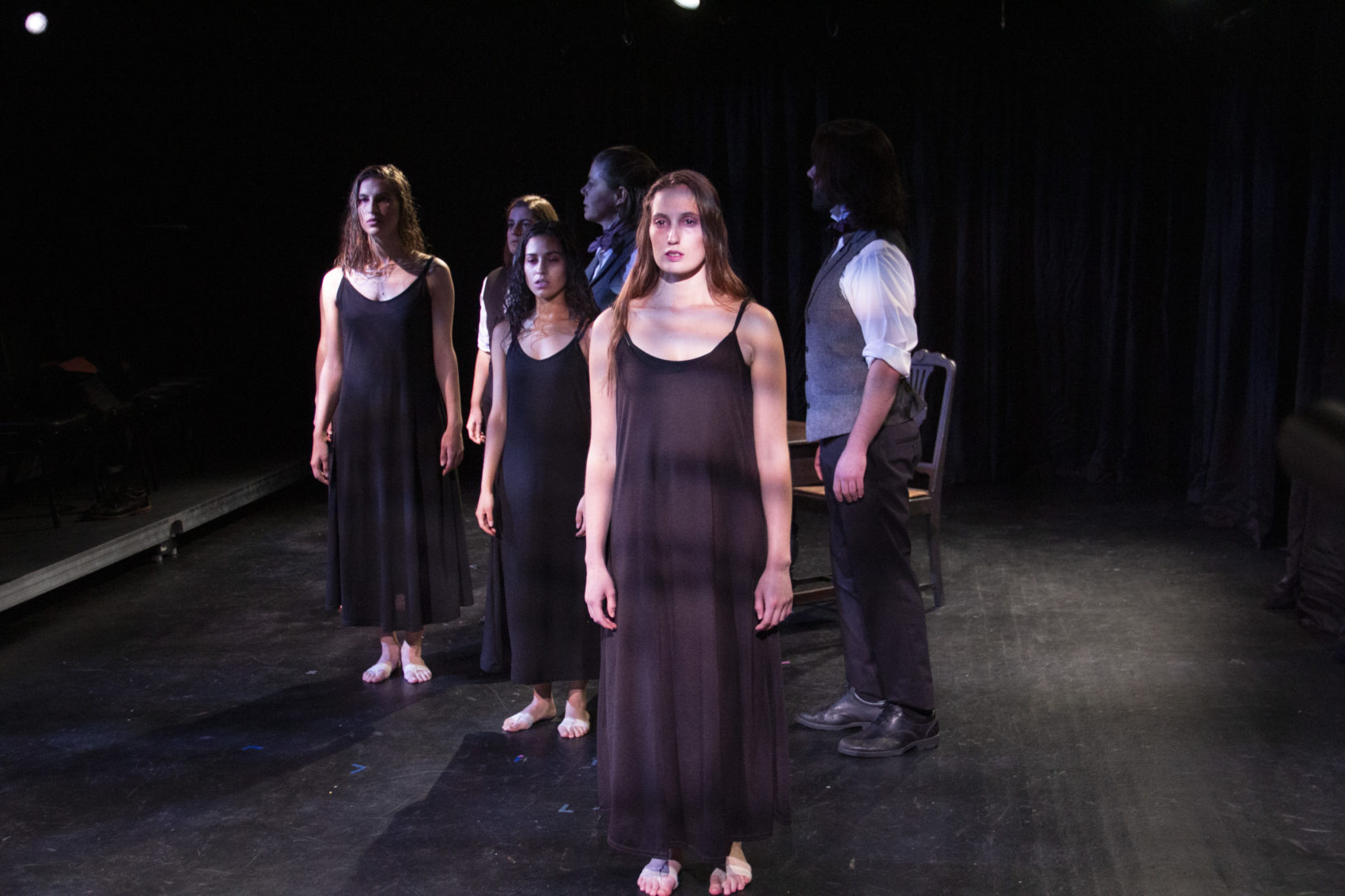 "Foreground, front to back: Siobhán Carroll, Luz Lopez, and Elena Toppo. Background, front to back: C. Padraig Sullivan, Christine Power and Jessica Golden in ""My Fascination with Creepy Ladies."" (Courtesy Anthem Theatre Company)"