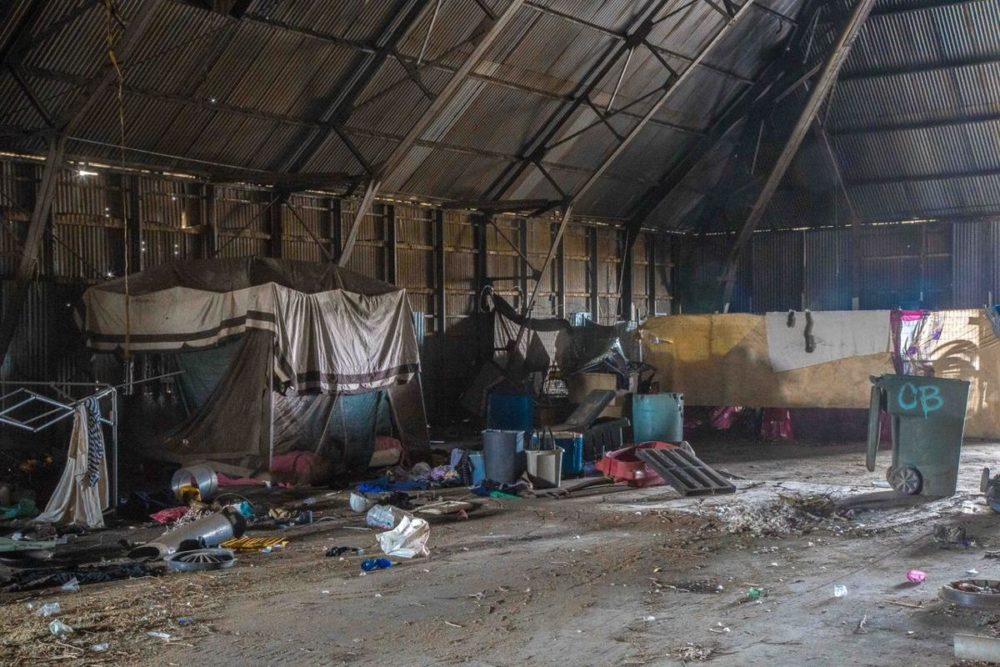 An abandoned factory warehouse serves as shelter for some homeless people in Bakersfield, California. (Photo by Michael K. Chadburn)