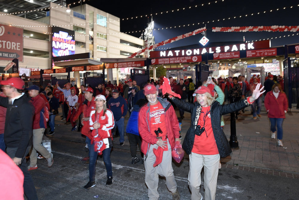 Washington Nationals fans leave the ballpark after the Nats swept the Cardinals in the NLCS. (Nick Wass/AP)