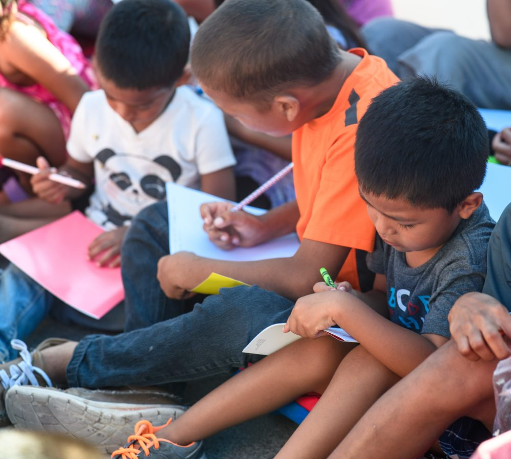 Asylum-seeking children draw during Sunday classes led by Team Brownsville. (Courtesy Paul Goyette)