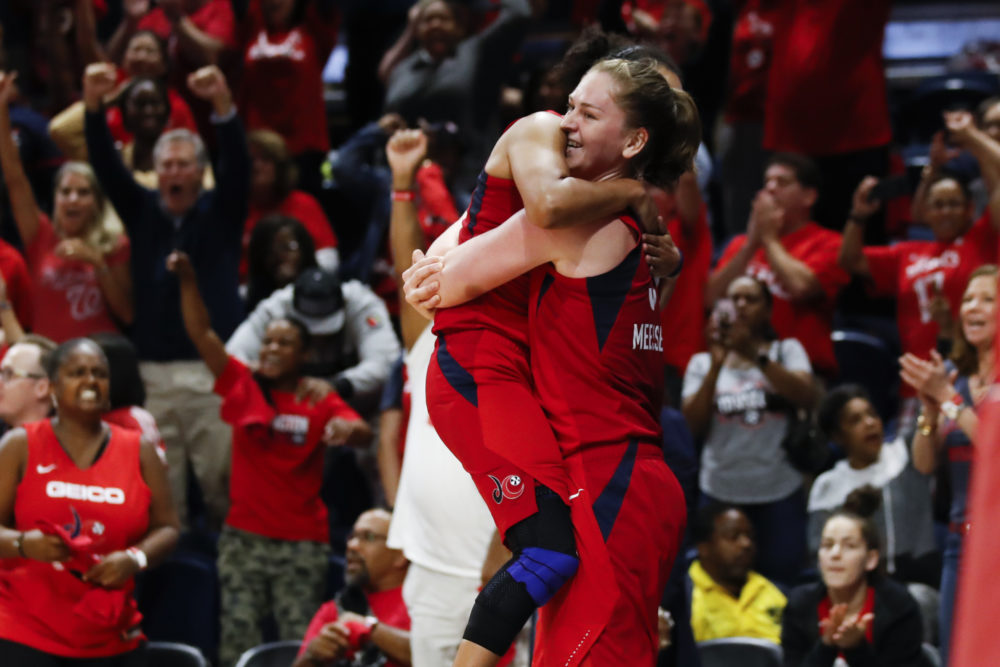 Washington Mystics guard Kristi Toliver, left, jumps into the arms of Emma Meesseman at the end of Game 5 of the WNBA Finals. (Alex Brandon/AP)