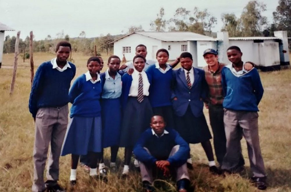 The author, pictured second from right, with students during his time as a Peace Corps volunteer in Zimbabwe. (Courtesy)