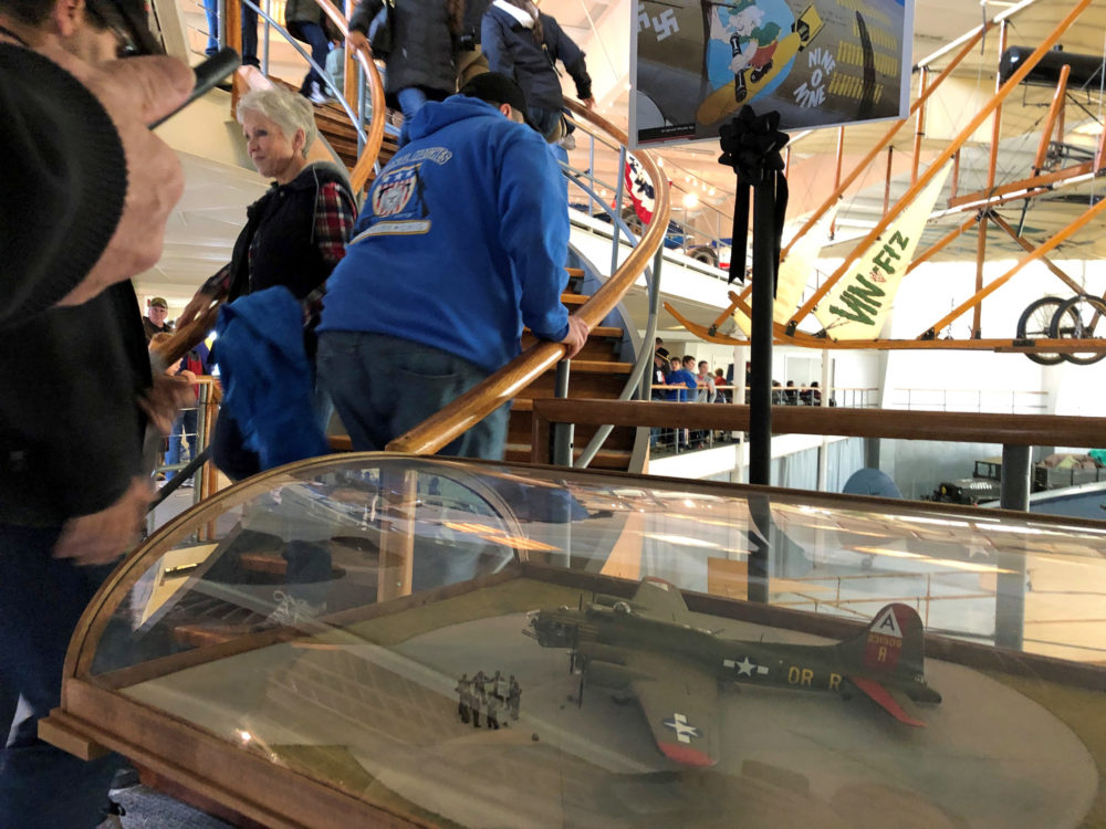 Visitors at the Collings Foundation's American Heritage Museum in Hudson file past a model of the B-17 that crashed in October. (Callum Borchers WBUR)