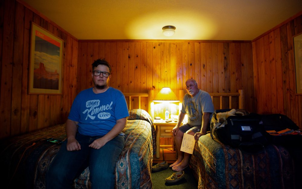 Chick McClure and Chas McClure (back) sit in a hotel during their road trip in Utah. (Courtesy T. Chick McClure)