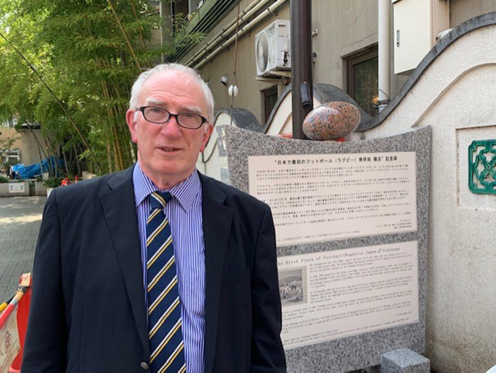 Historian Mike Galbraith by the plaque recognizing Yokohama's rugby history. (Courtesy Mike Galbraith)