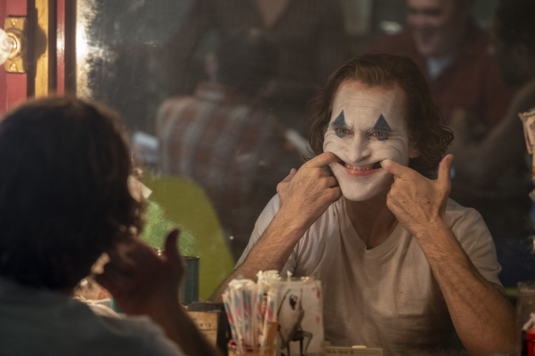 "Joaquin Phoenix as Arthur Fleck in ""Joker."" (Courtesy Niko Tavernise/Warner Bros. Pictures)"