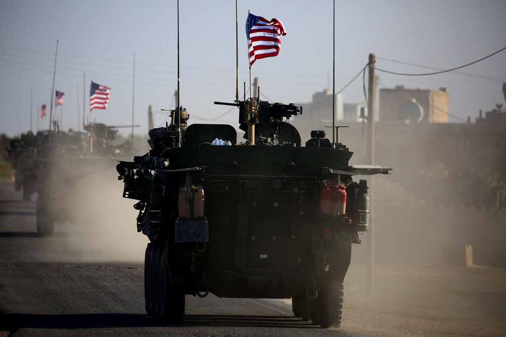 A convoy of US forces armoured vehicles drives near the village of Yalanli, on the western outskirts of the northern Syrian city of Manbij, on March 5, 2017. (Delil Souleiman/AFP/Getty Images)