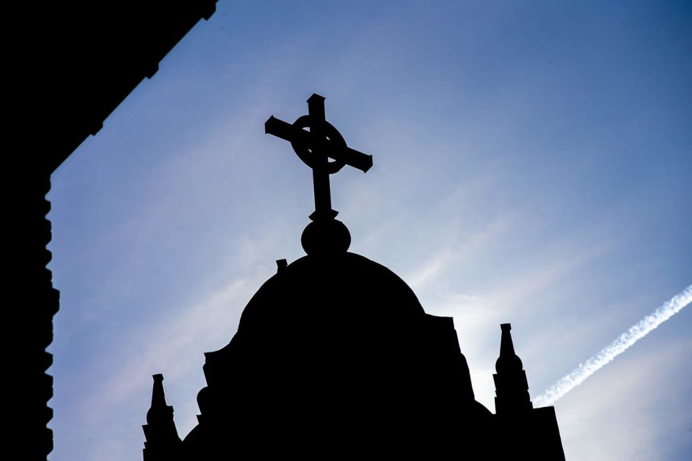 The cross atop Alumni Hall at the College of the Holy Cross in Worcester. (Jesse Costa/WBUR)