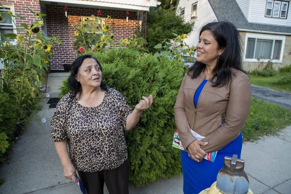 While canvasing through a Roslindale neighborhood in September 2019, Alejandra St. Guillen, left, listens to resident Radrigunda Marmanillo, speak about some of the issues in the area.  (Jesse Costa/WBUR)