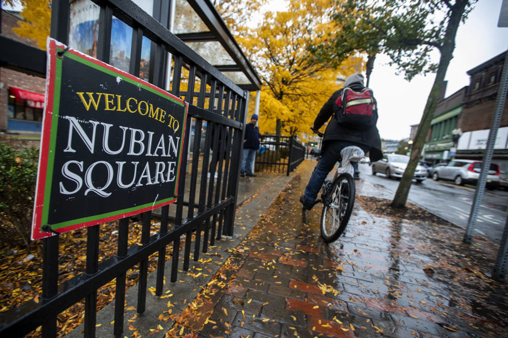 "A ""Welcome to Nubian Square"" sign at the gate of the Dudley Square Plaza on Washington Street. (Jesse Costa/WBUR)"