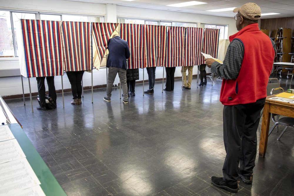 Residents vote at a polling place on Concord Avenue in Cambridge. (Robin Lubbock/WBUR)