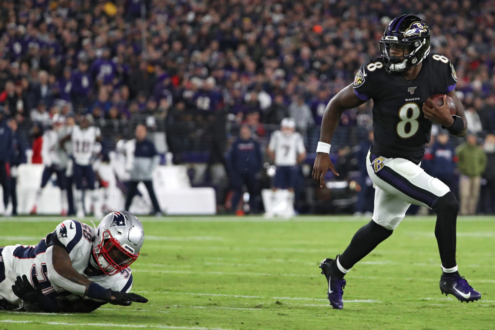 Baltimore Ravens quarterback Lamar Jackson led the Ravens to a victory over the Patriots on Sunday. (Todd Olszewski/Getty Images)