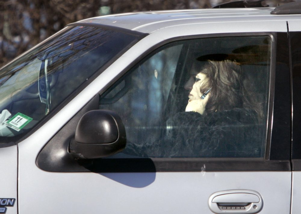A driver talks on a cell phone while driving in Newark, N.J. in 2008. (Mike Derer/AP)