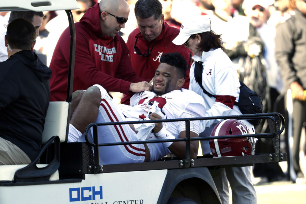 Alabama quarterback Tua Tagovailoa is carted off the field after his injury in the first half of last Saturday's game against Mississippi State. (Rogelio V. Solis/AP)
