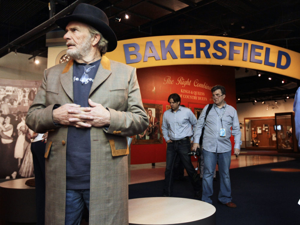 The late Merle Haggard, left, views an exhibit on the Bakersfield sound at the Country Music Hall of Fame and Museum in Nashville, Tenn. (Mark Humphrey/File/AP)
