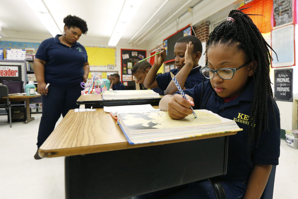 Elize'a Scott, a Key Elementary School third grade student, right, reads under the watchful eyes of teacher Crystal McKinnis, left, Thursday, April 18, 2019, in Jackson, Miss. (Rogelio V. Solis/AP)