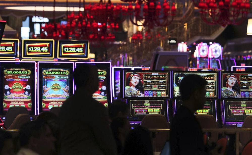 Casino workers near the gaming floor at the Encore Boston Harbor casino in Everett. (AP Photo/Charles Krupa)