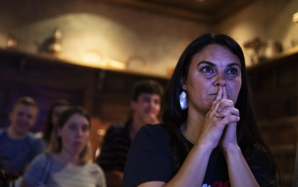 Lacey Hunt, a supporter of Democratic presidential candidate entrepreneur Andrew Yang, watches as he speaks during a Democratic presidential debate at a watch party in Atlanta, Thursday, June 27, 2019. (David Goldman/AP)