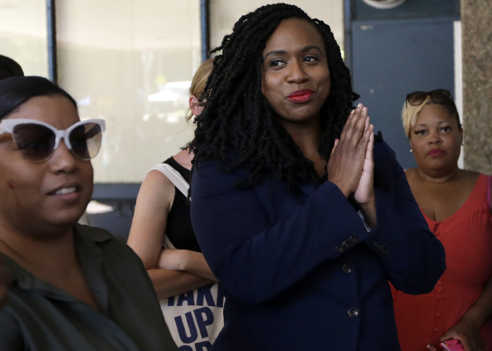 U.S. Rep. Ayanna Pressley, D-Mass., stands during ceremonies before the start of the Roxbury Unity Parade on July 21, 2019, in Boston's Roxbury neighborhood. (Steven Senne/AP)