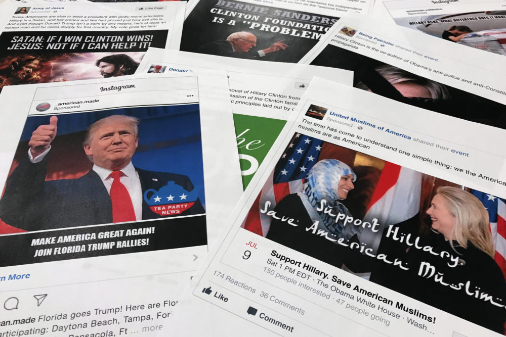 Some of the Facebook and Instagram ads linked to a Russian effort to disrupt the American political process and stir up tensions around divisive social issues, released by members of the U.S. House Intelligence committee, are photographed in Washington. (AP Photo/Jon Elswick, File)