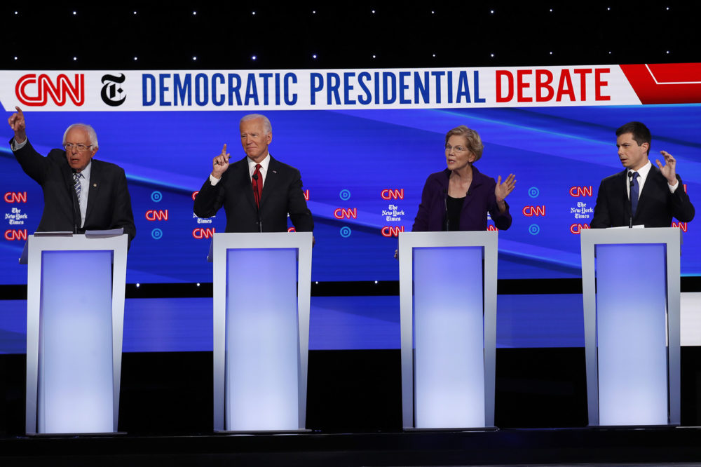 Democratic presidential candidate Sen. Bernie Sanders, I-Vt., from left, former Vice President Joe Biden, Sen. Elizabeth Warren, D-Mass., and South Bend Mayor Pete Buttigieg all gesture to speak during a Democratic presidential primary debate hosted by CNN/New York Times at Otterbein University, Tuesday, Oct. 15, 2019, in Westerville, Ohio. (John Minchillo/AP)