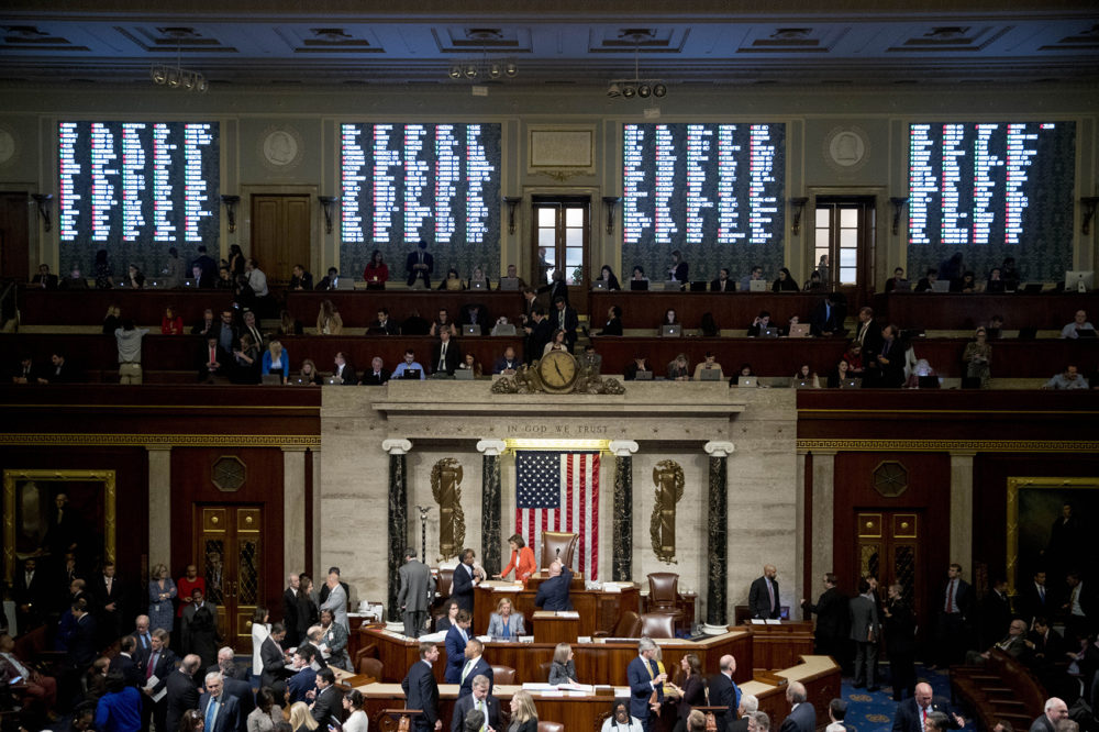 Vote tallies are displayed as House members vote on a resolution on impeachment procedures. (Andrew Harnik/AP)