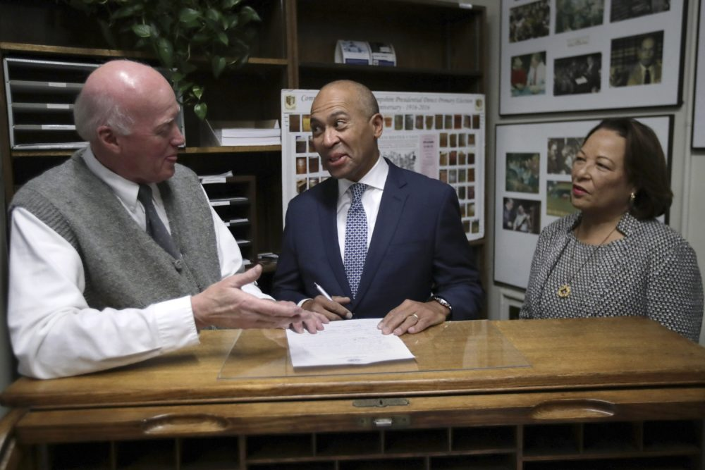 Democratic presidential candidate former Massachusetts Gov. Deval Patrick speaks to New Hampshire Secretary of State Bill Gardner, left, as he files to have his name listed on the New Hampshire primary ballot, Thursday, Nov. 14, 2019, in Concord, N.H. At right is his wife Diane Patrick. (Charles Krupa/AP)